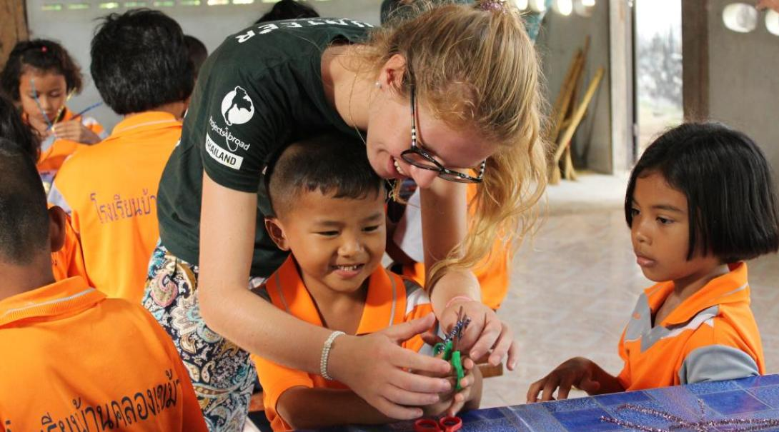 Care volunteers looking after school children in Thailand